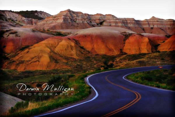 A highway snakes through Badlands, South Dakota, USA