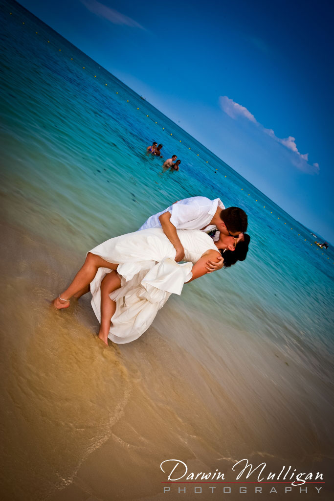 Nicole & Matt stop for a romantic kiss on their Jamaica destination wedding