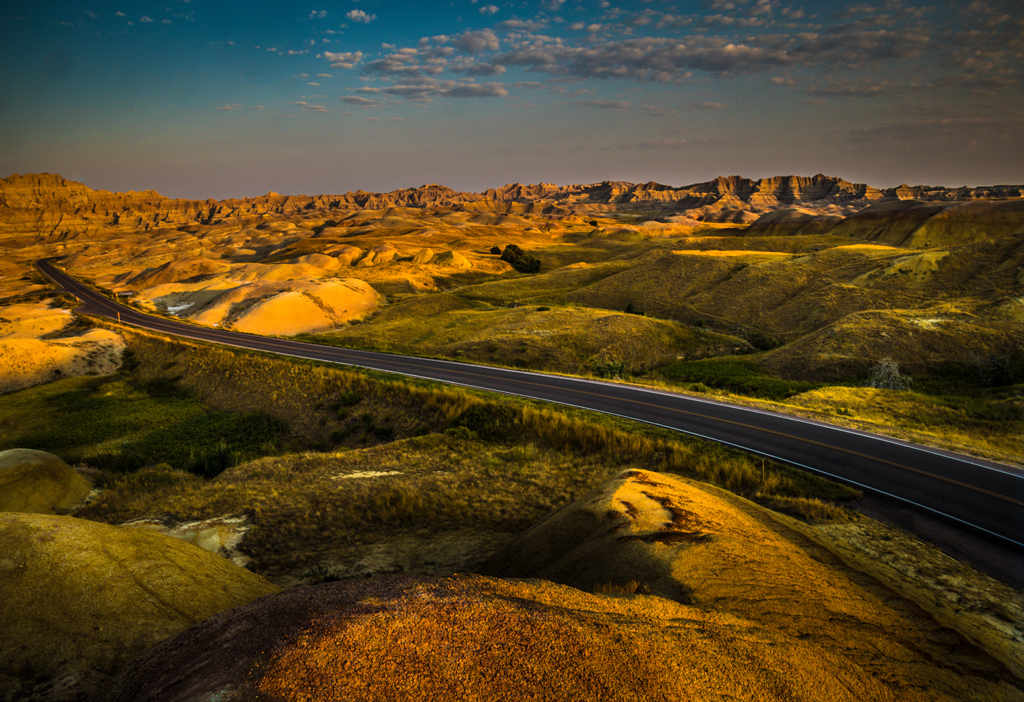 Early-morning-photo-of-highway-going-through-Badlands-National-Park-South-Dakota