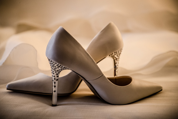 Edmonton wedding photographer - dress and brides shoes detail photograph