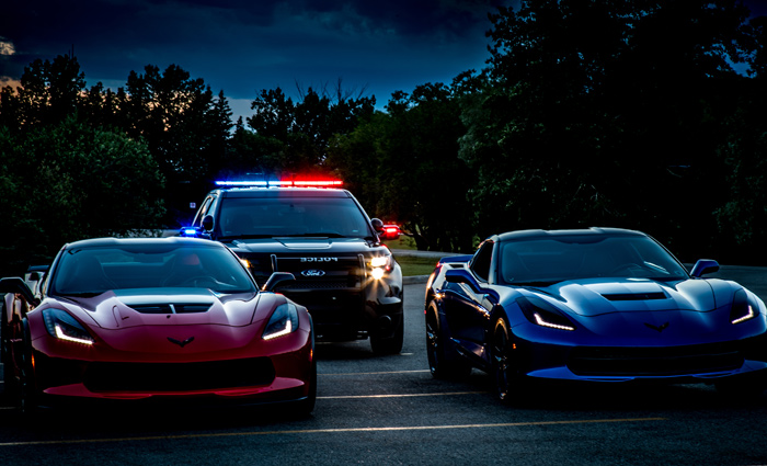 Set up photo with 2 Corvettes and Police