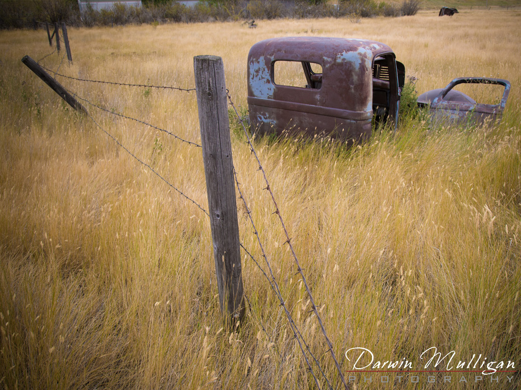 Abandoned-truck-and-fence-in-field-Kevin-Montana