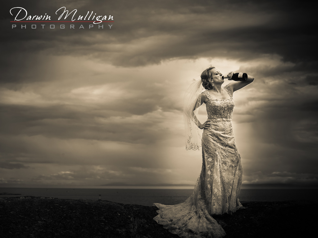 Fun-wedding-photography-with-bride-chugging-champagne