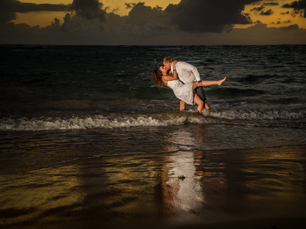 Sunrise kiss in the ocean for Trash the Wedding Dress. Destination wedding at Punta Cana, Dominican Republic
