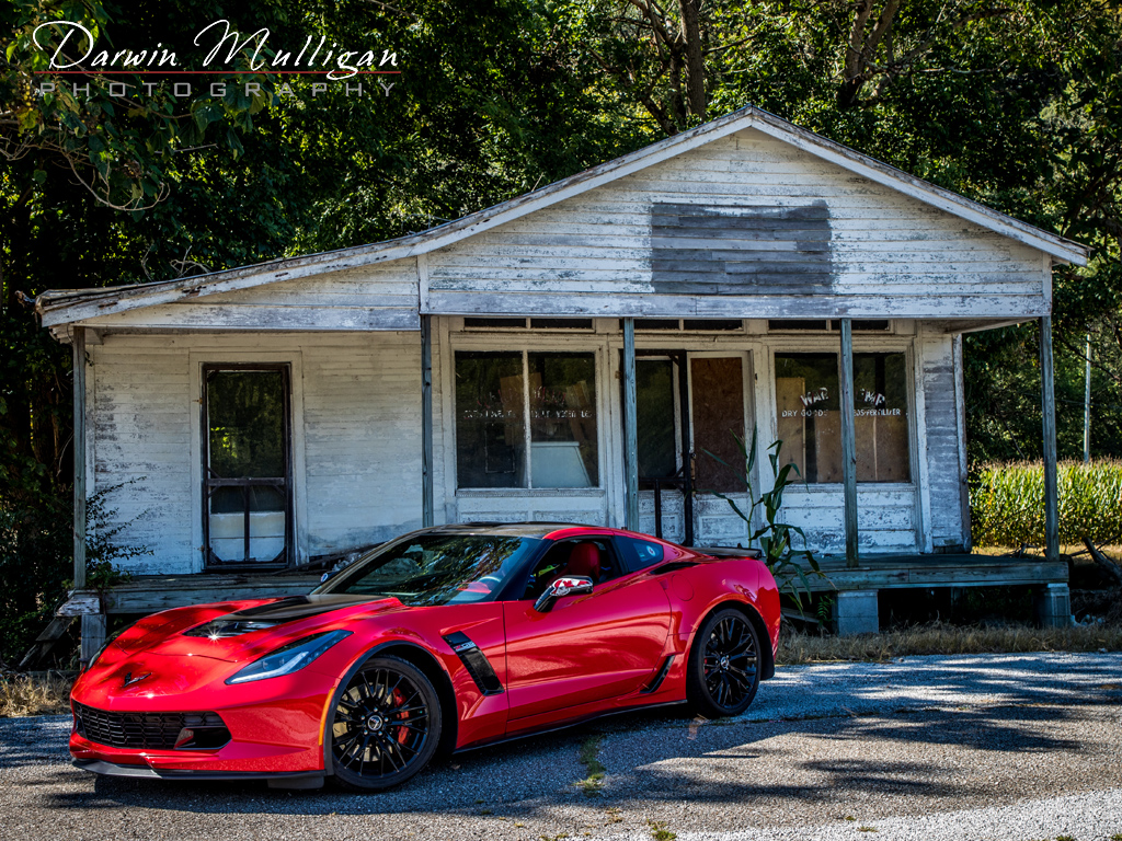 Abandoned building and my Torch Red Z06 Corvette