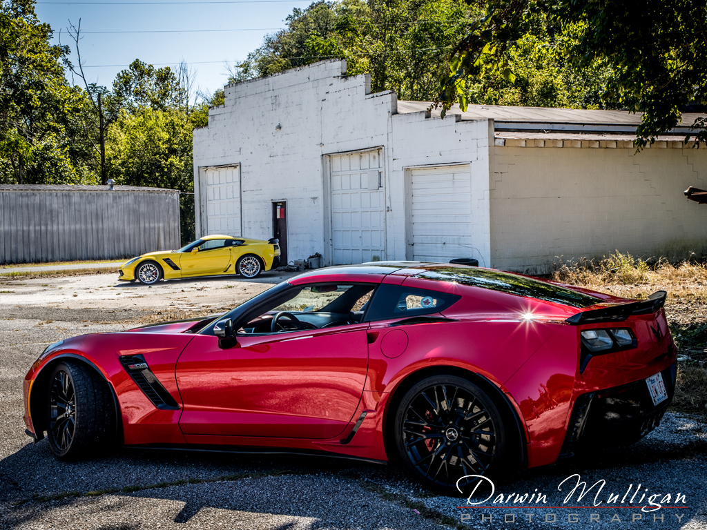 Two Z06 Corvettes and abandoned building