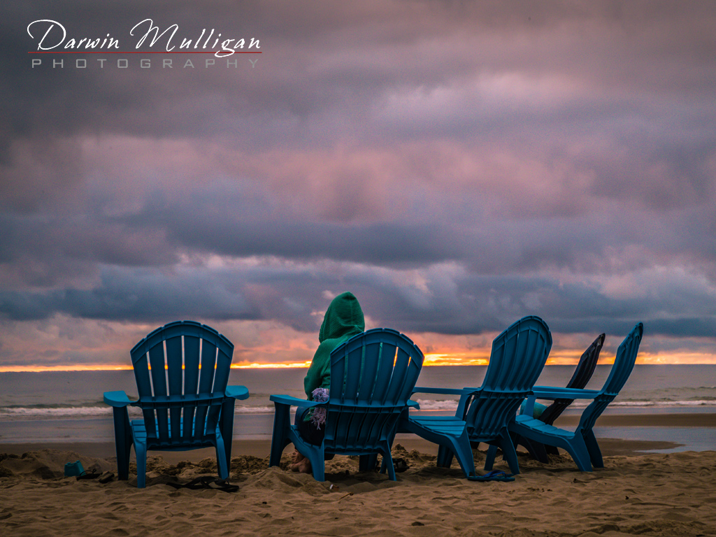 Watching the sun set at Cannon Beach on the Oregon Coast
