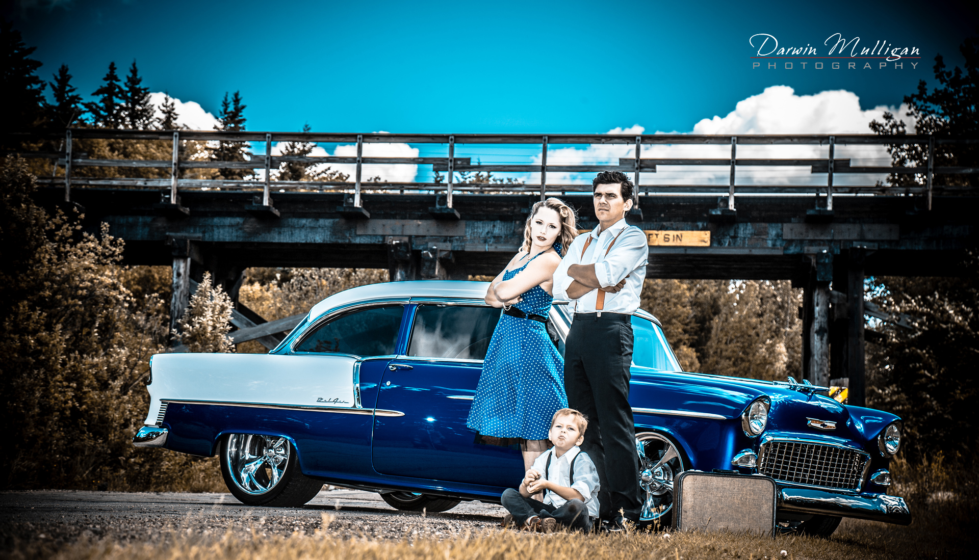 1955 Chevy Bel Air with couple and child posing
