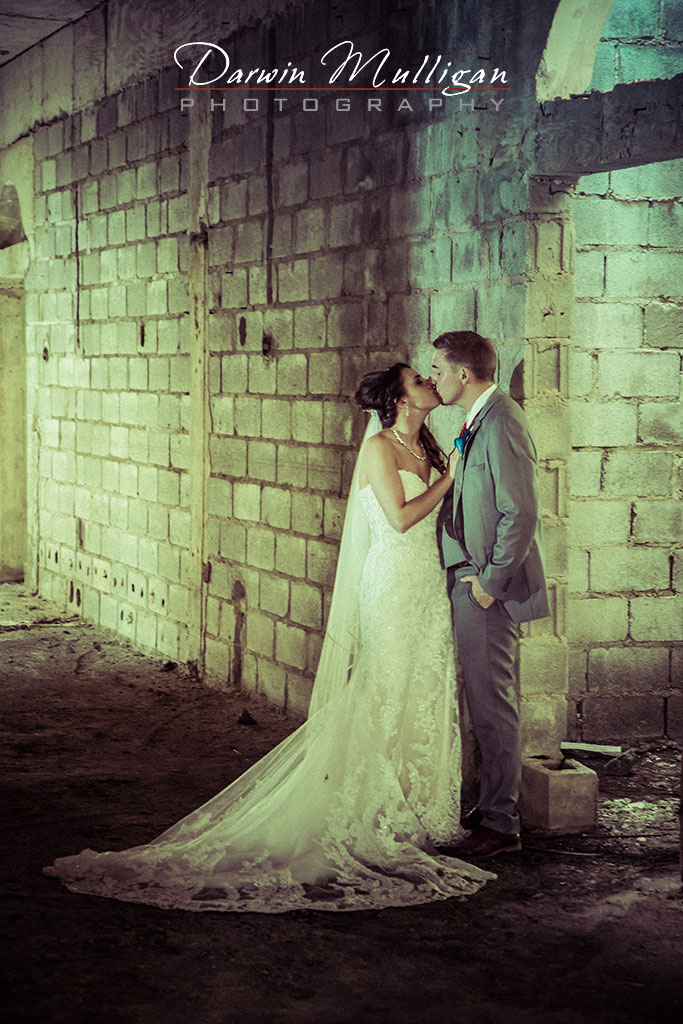 Bride and Groom Kissing In An Abandoned House