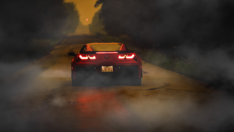 Torch Red Corvette Z06 on a Smoky Morning