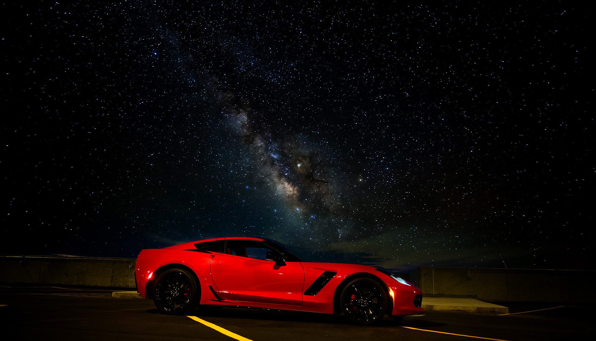 Chevy Corvette Z06 on a parkade rooftop at night with Milky Way visible