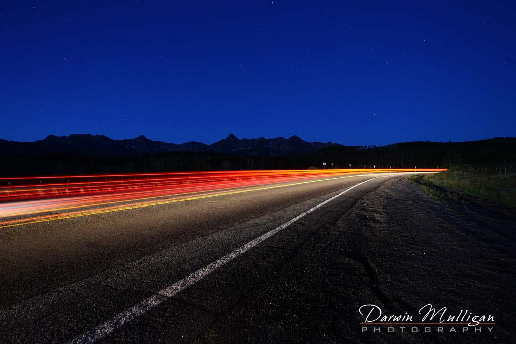 cars light tracing the screen on a dark highway in Colorado and Dallas